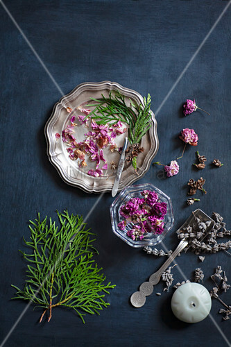 Dried flowers and thuja sprigs on old plates