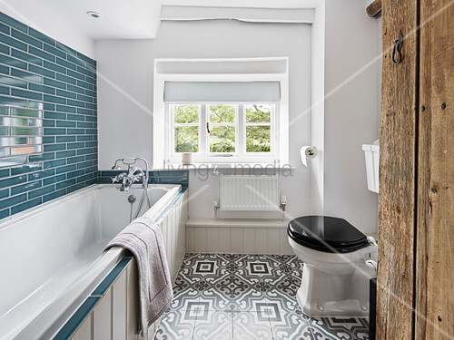 Modern and bright bathroom with blue accents