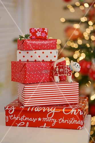 Christmas presents wrapped in red-and-white paper