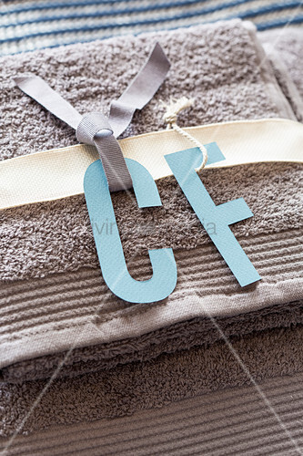 Handmade paper initials for guest towels