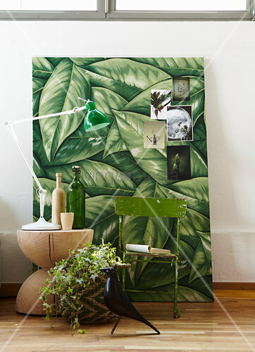 Urban Jungle accessories: artwork, folding chair, wooden table and lamp
