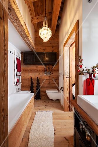 Chandelier in narrow bathroom in chalet