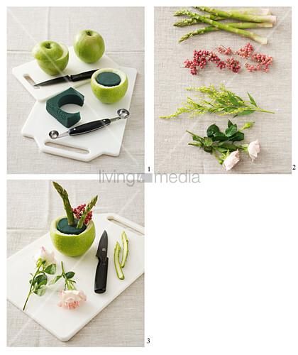 Anleitung für Gesteck mit Rosen und Spargel in einem grünen Apfel