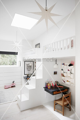 White twin loft beds above desks in sibling's bedroom