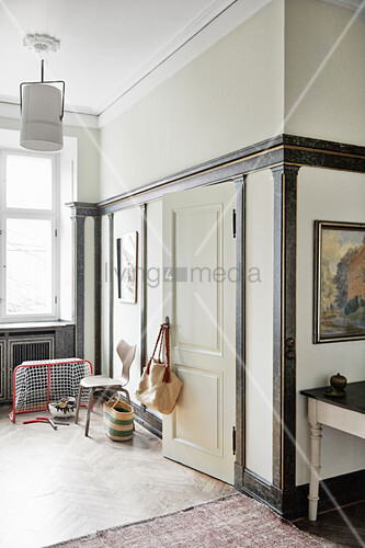 Miniature ice hockey goal in corner of room with marbled wall panelling