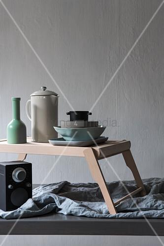 Crockery on tray with legs above speaker
