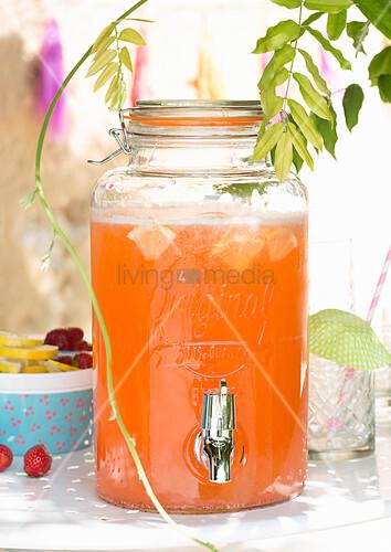 Orange drink in glass drinks dispenser