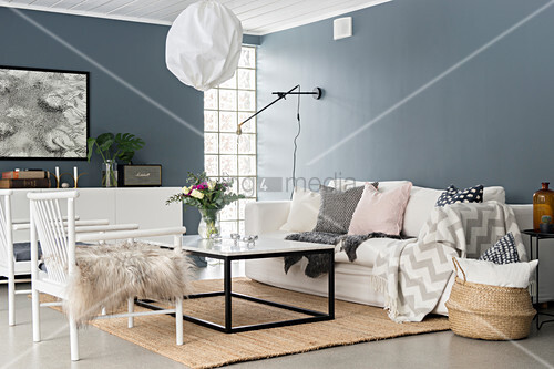 White chairs and coffee table in living room with grey walls