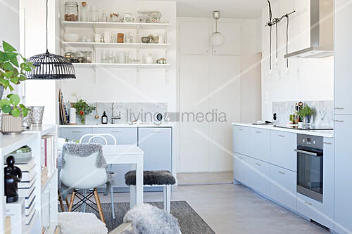 Open-plan kitchen-dining room in white and dove grey