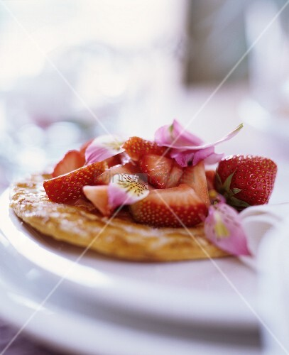 Strawberry tart decorated with petals