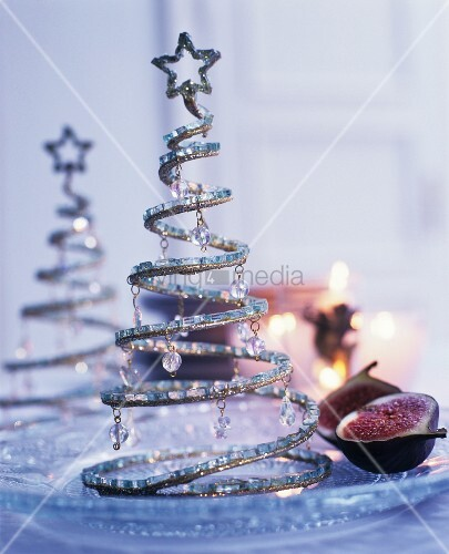 Small Christmas-tree ornaments made from wire spirals and decorated with beads