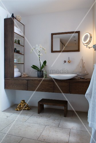 Wooden washstand and shelving in bathroom