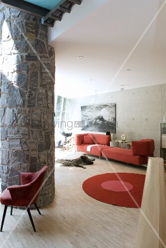 Stone column and red designer furniture in living room