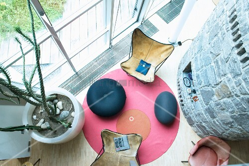 View down onto two Butterfly chairs on round rug