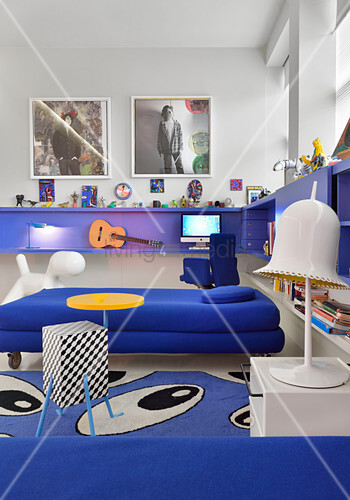 L-shaped, royal-blue, wall-mounted shelf in blue and white child's bedroom
