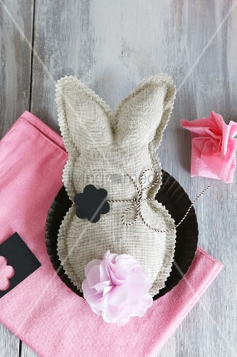 Fabric rabbit with zig-zag edge and paper flowers