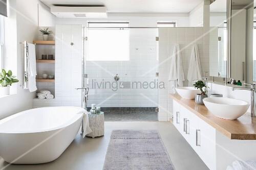 Free-standing bathtub in large bright bathroom