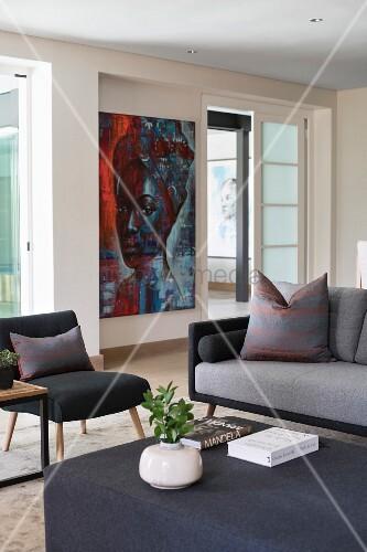 Painting behind modern sofa set