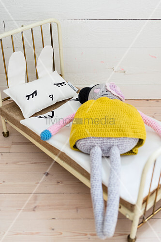 Crocheted doll on dolls' bed