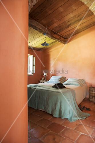 Double bed in Mediterranean bedroom