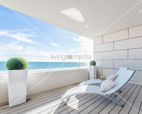 Two loungers on balcony with panoramic sea view