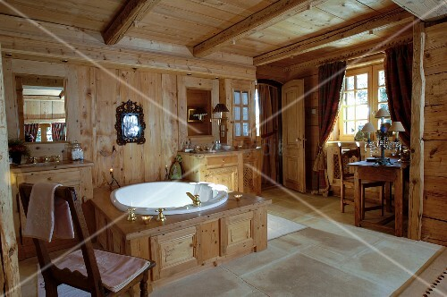 Wood-clad bathtub in rustic, country-house-style bathroom