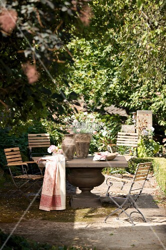 Solid stone table and chairs in seating area in garden