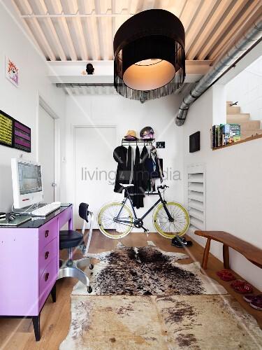 Purple desk and animal-skin rug