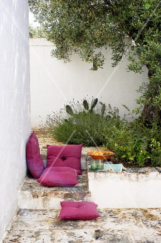 Floor cushions and picnic on terrace