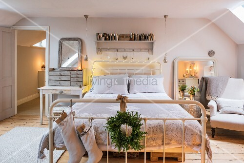 Christmas decorations in romantically lit bedroom