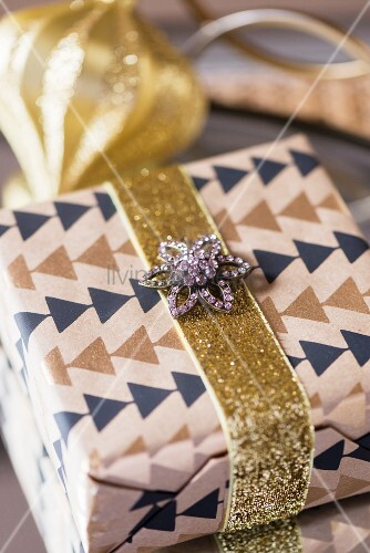 Vintage brooch decorating wrapped present