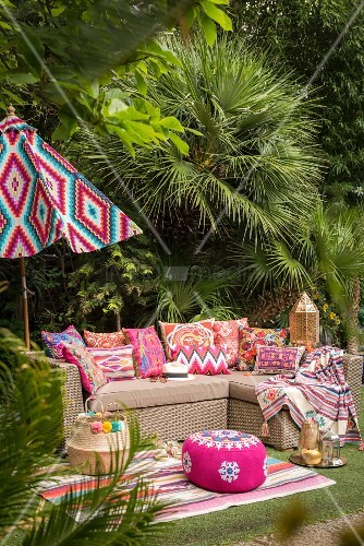 Outdoor sofa and exotic decorations in garden seating area