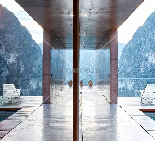 Reflections from hallways and balcony of modern architect-designed house