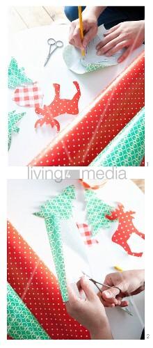 Aufmalen und ausschneiden verschiedener weihnachtlicher Motive aus Klebefolie