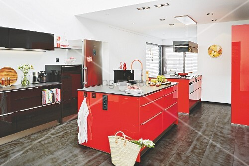 A spacious kitchen with two red kitchen islands and a black unit