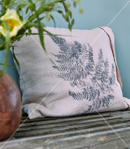 Cushion printed with fern leaf
