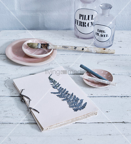 Pressed and painted fern leaf on hand-tied book