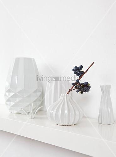 White structured vases on shelf