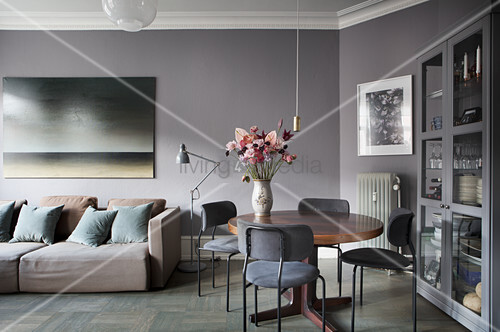 Sofa and dining table in interior in shades of grey