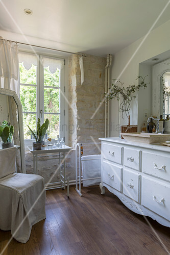 Antique white washstand in bathroom
