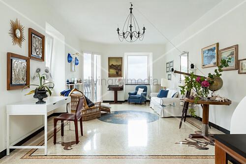 Terrazzo floor and chandelier in Mediterranean interior
