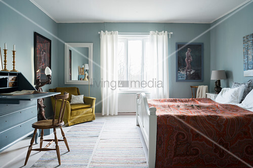 Classic bedroom with pale blue walls