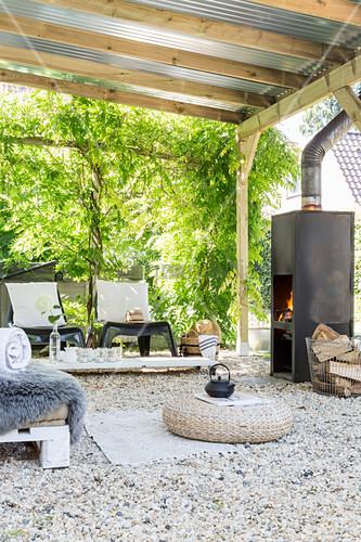 Log burner on roofed terrace