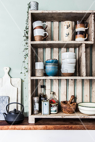 Crockery on open-fronted wooden shelves