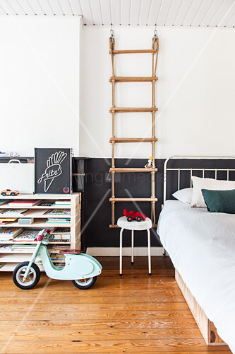 Rope ladder next to bed in boy's bedroom