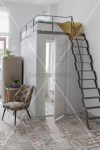 Metal ladder leading to sleeping platform above bathroom