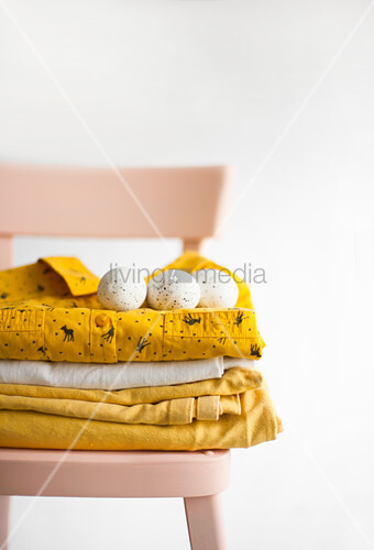 Speckled eggs on stacked linen