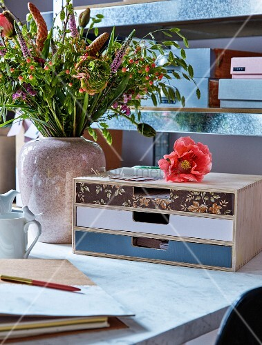 Desktop drawers with decoupage fronts in different colours
