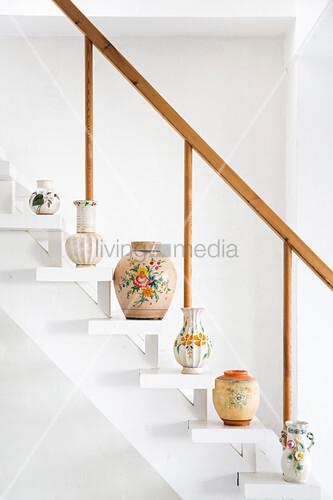 Vases arranged on white staircase