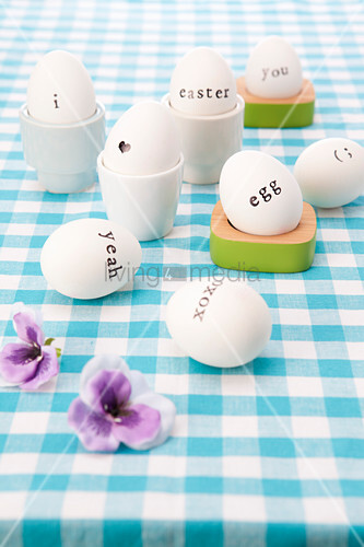 White Easter eggs decorated with black letting